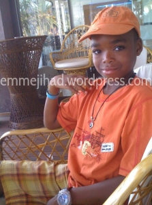 Junior Juma on his sister Annaa's favorite picture, taken about five years ago